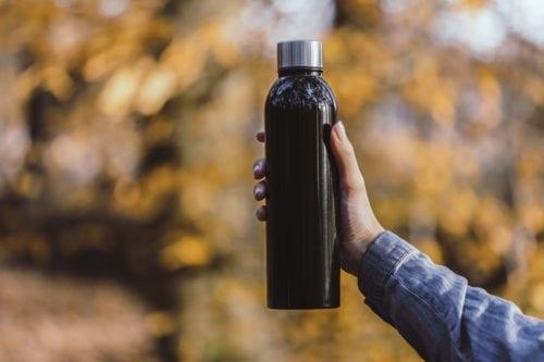 Branded Apollo 500ml Bottles - Black held in woods
