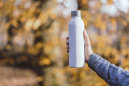 Branded Apollo 500ml Bottles - White held in woods